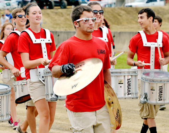 WARREN DILLAWAY / Star Beacon<br /> TED KHON (with cymbals) at the rest of the Jefferson High School band performed Tuesday evening during the Ashtabula County Fair parade at the fairgrounds in Jefferson.