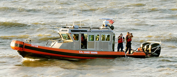 WARREN DILLAWAY / Star Beacon<br /> A U.S. COAST GUARD vessel was used to search the shroreline of Lake Erie for an apparent missing swimmer along Lake Road West in Saybrook Township Friday evening.