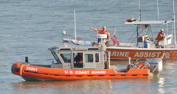 WARREN DILLAWAY / Star Beacon<br /> A MARINE Assist boat, background, works with a U.S. Coast vessel during a search for a missing 13 year old swimmer lost on Lake Erie Friday evening along Lake Road West in Saybrook Township.