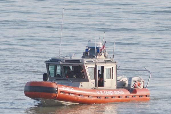 WARREN DILLAWAY / Star Beacon<br /> A U.S. Coast Guard vessel patrols in Lake Erie off Lake Road West in Saybrook Township while seeking a 13 year old  boy presumed drowned on Friday night.