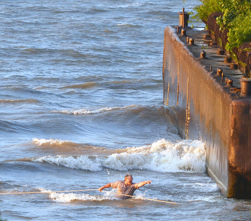 WARREN DILLAWAY / Star Beacon<br /> EFFORTS TO find an apparent missing swimmer were made more difficult by significant waves pounding the shoreline along Lake Road West in Saybrook Township.