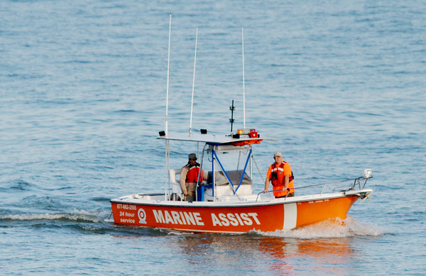 WARREN DILLAWAY / Star Beacon<br /> A MARINE Assist boat was one of many assets used to search for a missing 13 year old swimmer lost on Lake Erie Friday evening along Lake Road West in Saybrook Township.