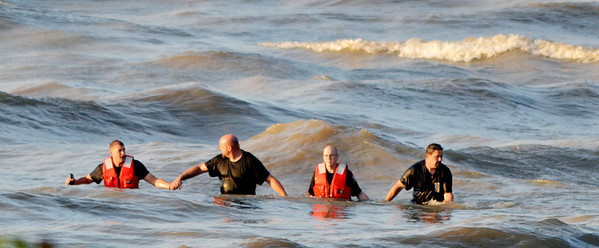 WARREN DILLAWAY / Star Beacon<br /> RESCUE WORKERS from a human chain along the shroreline of Lake Erie while looking for an apparent missing swimmer along Lake Road West in Saybrook Township Friday evening.