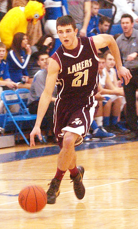 WARREN DILLAWAY / Star Beacon<br /> QUINTIN RATLIFF of Pymatuning Valley dribbles up court on Friday evening during a game at Grand Valley.