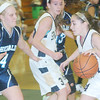 WARREN DILLAWAY / Star Beacon<br /> JESSICA THOMPSON (right) of Conneaut dribbles to the basket with St. John's Liv Cimmorelli defending on Saturday afternoon in Conneaut.
