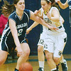 WARREN DILLAWAY / Star Beacon<br /> MIKENZIE STENROOS (left) of St. John dribbles up court with Conneaut's Lydia Coccitto defending Saturday in conneaut.