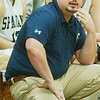 WARREN DILLAWAY / Star Beacon<br /> TONY PASANEN, Conneaut girls basketball coach, watches the action on Saturday afternoon during a home game with St. John.