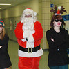 "WARREN DILLAWAY / Star Beacon<br /> SANTA ""SECRET SERVICE"" ELVES Ashley Muscatelli (left) and Allee Coates accompany Santa as he enters the Breakfast with Santa Saturday morning at Edgewood High School."
