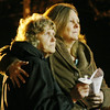 MARGIE NETZEL / Star Beacon<br /> MADISON RESIDENT KATHY JERIC hugs neighbor Judy Pauley at a vigil for the victims of the Sandy Hook Elementary shooting in Connecticut. The vigil, held Sunday night in Madison square, was organized by Behm Family Funeral Homes and Crematory.