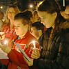 MARGIE NETZEL / Star Beacon<br /> MADISON SISTERS Mackenzie Moran, 18, and Megan Moran, 13, hold candles for the victims of the Sandy Hook Elementary shooting in Connecticut. The vigil, held Sunday night in Madison square, was organized by Behm Family Funeral Homes and Crematory.