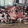 WARREN DILLAWAY / Star Beacon<br /> BRICKS FROM a 135 foot smokestack at the site of the former Ashtabula High School lay in a pile of rubble after it was demolished Sunday morning.