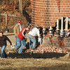 WARREN DILLAWAY / Star Beacon<br /> COSMO IAMURRI (left), owner of Pro Quality Land Developers, and his employees prepare to light support beams during a demolition of a 135 foot smokestack on the site of the former Ashtabula High School.