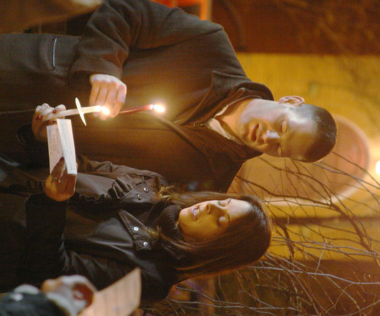 MARGIE NETZEL / Star Beacon<br /> TREVOR AND AMY BEHM sing at a candlelight vigil for the victims of the Sandy Hook Elementary shooting in Connecticut. The vigil, held Sunday night in Madison square, was organized by Behm Family Funeral Homes and Crematory.