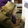MARGIE NETZEL / Star Beacon<br /> MADISON RESIDENT KATHY JERIC signs a poster for the victims of the Sandy Hook Elementary shooting in Connecticut. The vigil, held Sunday night in Madison square, was organized by Behm Family Funeral Homes and Crematory.