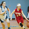 WARREN DILLAWAY / Star Beacon<br /> CARRIE PASCARELLA (14) of Edgewood dribbles up court with St. John's Mikenzie Stenroos in hot pursuit Thursday night at Mahoney Gymnasium in Ashtabula.