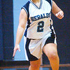 WARREN DILLAWAY / Star Beacon<br /> EMILY POWERS of St. John dribbles up court Thursday during a home game with Edgewood.