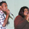WARREN DILLAWAY / Star Beacon<br /> ISAIAH SALTERS and Jewell Chappell lead songs at the G.O. Ministries Christmas party Saturday in Ashtabula.