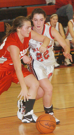 WARREN DILLAWAY / Star Beacon<br /> GIA SATURDAY (left) of Edgewood dribbles up court with Jefferson's Deanna Comp (22) Saturday evening at Jefferson.