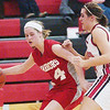 WARREN DILLAWAY / Star Beacon<br /> CARRIE PASCRELLA (14) of Edgewood tries to dribble around Jefferson defender Ariann Barile Saturday night at Jefferson.