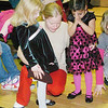 WARREN DILLAWAY / Star Beacon<br /> SHANNON MANLEY (middle) prays with Autumn Evans, 4, (left) and Katuana Jackson, 4, both of Ashtabula, Saturday during the G.O. Ministries Christmas Party. The prayer was to remember the people killed in the Newtown, Conn., shooting.