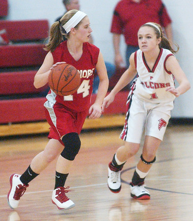 WARREN DILLAWAY / Star Beacon<br /> CARRIE PASCARELLA (14) of Edgewood dribbles up court with Jefferson's Emily Smock defending Saturday evening in Jefferson.