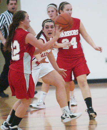 WARREN DILLAWAY / Star Beacon<br /> ARIANNA BARILE (center facing) of Jefferson defends Edgewood's Taylor Diemer with Warrior  Julie Rich in the background Saturday at Jefferson.