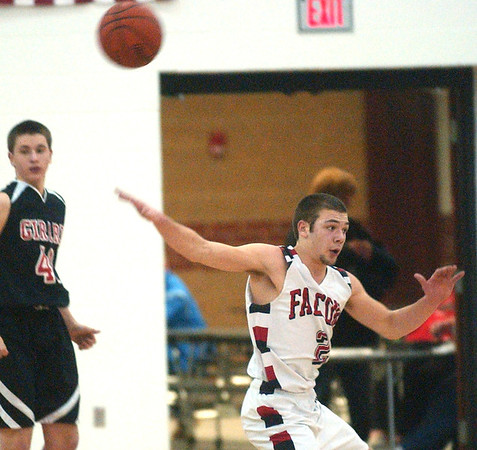 WARREN DILLAWAY / Star Beacon<br /> JACOB HAMILTON (2) of Jefferson reacts to a pass on Friday evening during a home game with Girard. Girard's Nick Kalan follows the play.