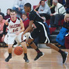 WARREN DILLAWAY / Star Beacon<br /> BRETT POWERS (left) of Jefferson defends Girard's Craig Randall Friday evening at Jefferson.