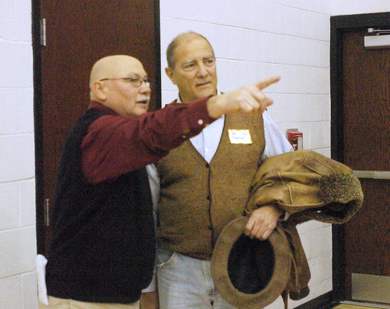 WARREN DILLAWAY / Star Beacon<br /> TIM MIZER, organizer of a Jefferson basketball players reunion prior to Friday's game with Girard, instructs Jon Freeman on where to go during the event.