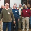 WARREN DILLAWAY / Star Beacon<br /> MICKEY ZIGMUND leads a group of Jefferson basketball playing alumni on to the floor Friday evening during a ceremony prior to the Jefferson-Girard boys basketball game.