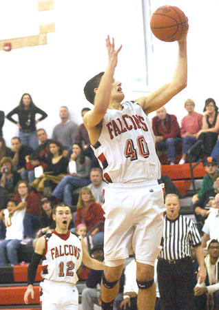 WARREN DILLAWAY /Star Beacon<br /> JACOB ADAMS (40) of Jefferson drives to the basket whle teammate Brett Powers reacts Friday night during a home game with Girard.