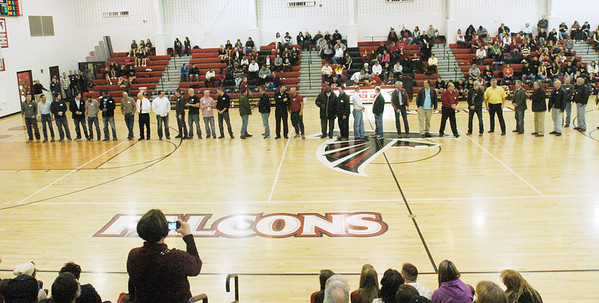 WARREN DILLAWAY / Star Beacon<br /> JEFFERSON ALUMNI basketball players are honored prior to the Jefferson-Girard boys home game Friday night.