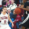WARREN DILLAWAY / Star Beacon<br /> JACOB HAMILTON (2) of Jefferson defends Girard's Craig Randall Fridaynight at  Jefferson.