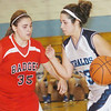 WARREN DILLAWAY / Star Beacon<br /> RAE ANN BENEDICT of St. John dribbles up court with Badger's Brandi Nitch defending on Saturday at Mahoney Gymnasium in Ashtabula.