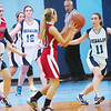 WARREN DILLAWAY / Star Beacon<br /> ST. JOHN defenders Brenna Powers (54), Mackenzie Stenroos (12), Rae Ann Benedict (far back left) and Alex Ferrante (11) defend Badger's Holly Masters (with ball) and Harlee Logan (42) on Saturday afternoon at Mahoney Gymnasium in Ashtabula.
