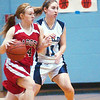 WARREN DILLAWAY / Star Beacon<br /> ALINA DELGARBINO (left) of Badger dribbles with Alex Ferrante of St. John defending Saturday afternoon at Mahoney Gymnasium in Ashtabula.