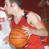 WARREN DILLAWAY / Star Beacon<br /> JACOB HAMILTON of Jefferson drives to the basket Tuesday evening during a game at Geneva.