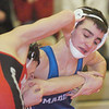WARREN DILLAWAY / Star Beacon<br /> JACOB STEIGNER of Madison attempts to escape the grasp  of Mentor's Nick DiSanto Thursday night during a 120 pound bout Thursday night at Mentor.