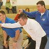 WARREN DILLAWAY / Star Beacon<br /> RYAN WIRTZBERGER (white shirt), Madison wrestling coach, and his assistants Tim Willis (right back) and Bob Vencill react to action Thursday night at Mentor.