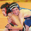 WARREN DILLAWAY / Star Beacon<br /> MIKE KINNEY of Madison (right) attempts to control  Mentor's Austin Victor Thursday night during a 106 pound bout Thursday night at Mentor.