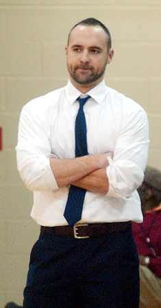 WARREN DILLAWAY / Star Beacon<br /> MARK TAYLOR, Lakeside boys basketball coach, keeps a close eye on the action on Friday night during a home game with University School.