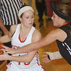 WARREN DILLAWAY / Star Beacon<br /> SARAH DEPP (left) of Geneva looks to pass the ball as Eastlake North defender Lynsey Englebrecht defends on Saturday afternoon at Geneva.