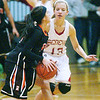 WARREN DILLAWAY / Star Beacon<br /> LINDSEY MAYLE of Geneva (13) defends an Eastlake North player on Saturday afternoon in Geneva.