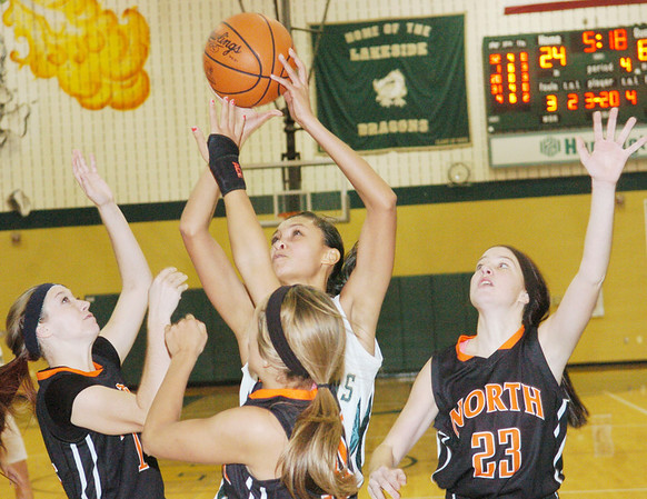 WARREN DILLAWAY / Star Beacon<br /> SHARISSE HUNT of Lakeside (with ball) prepares to shoot as (from left) Jess Dietrich (far left), Rachel Bizily (center front) and NMatalie Anold (23) surround her at Lakeside on Saturday afternoon.