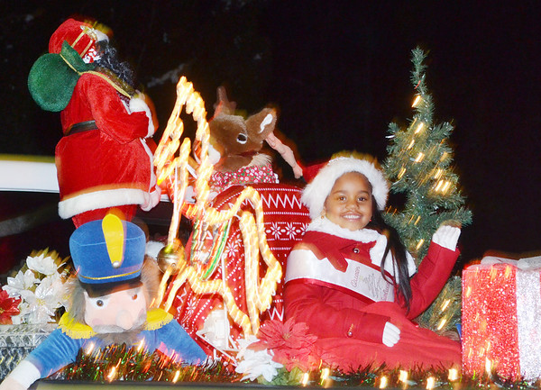WARREN DILLAWAY / Star Beacon<br /> JAMAICA JONES, 5, of Dorset Township, was all smiles while riding on a Christmas float Saturday evening during the Andover Christmas parade.