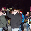 WARREN DILLAWAY / Star Beacon<br /> MEMBERS OF the Pymatuning Valley High School band  get fired up during the early stages of the  Andover Christmas parade.