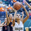 WARREN DILLAWAY / Star Beacon<br /> SHARISSE HUNT of Lakeside prepares to shoot on Saturday afternoon with Kourtney Klein of Eastlake North looking for a rebound.
