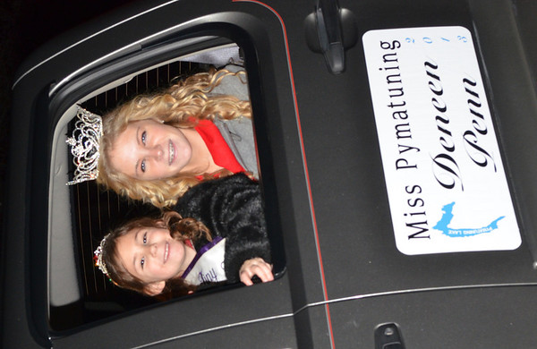 WARREN DILLAWAY / Star Beacon<br /> DENEEN PENN (right), Miss Pymatuning, and princess McKenzie Martin participate in the Andover Christmas parade on Saturday evening.