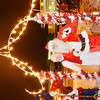 WARREN DILLAWAY / Star Beacon<br /> MR. AND Mrs. Santa Claus arrive in Andover Square following the Christmas parade on Saturday evening.
