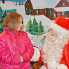 WARREN DILLAWAY / Star Beacon<br /> KIMBERLY RIDLE, 7, of Andover talks with Santa after the Andover Christmas parade on Saturday evening.